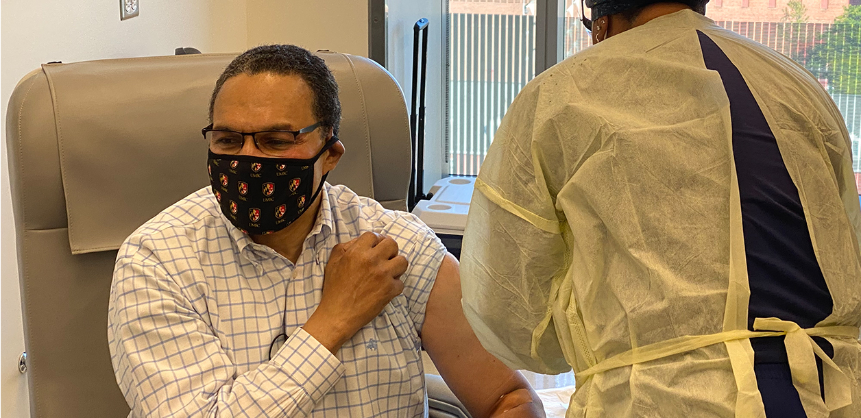 UMBC president Dr. Freeman Hrabowski gets injected with Moderna's trial COVID-19 vaccine