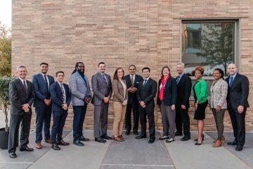 A line up of the 2021 Alumni Award winners, from left to right: Dr. Michael Summers, Deep Patel '19, Michael Berardi '19, Tewodross Melchishua Williams, M.F.A. '00, Dr. Michael Hassett, M.P.P. '17, Ph.D. '19, Dr. Kaitlyn Sadtler '11, Freeman Hrabowski, Sean Pang '04, M.A. '11, Dr. Kate Tracy, M.A. '01, Ph.D. '03, Dr. Scott Banta '97, Dr. Letitia Dzirasa '03, M11, Theresa Bruce '09, and UMBC Alumni Association President Brian Frazee '11, M.P.P. '12. Not pictured: Dr. Kizzmekia Corbett '08, M16, and Christine Osazuwa '11. Photo by Marlayna Demond '11.