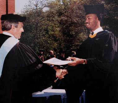 Remus Boxley shakes hands with then-President William M. Anderson Jr. at commencement in 1988, when he became the first member of his immediate family to graduate from college.