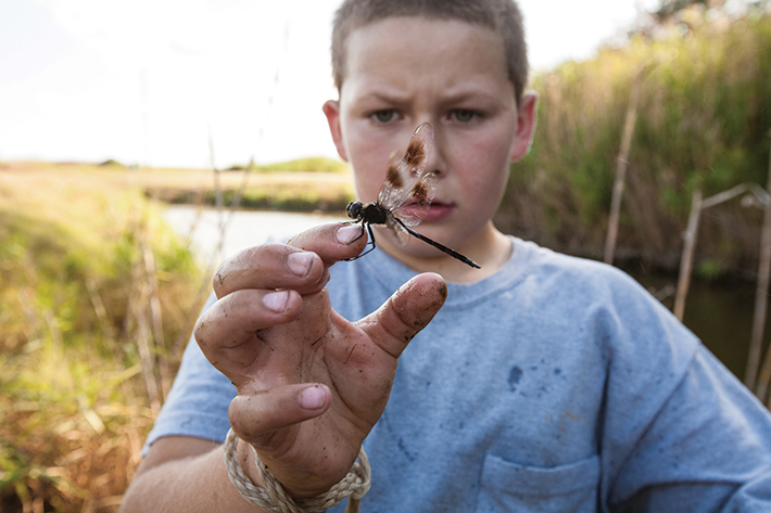 """I believe that an important story to tell is children's connection and disconnection to nature in today's America,"" Pinneo said. The National Wildlife Federation sent her to the Louisiana bayou country, where this boy lives a life outdoors. It's a life, she said, ""of discovery, fishing, looking for critters, and shrimping with his father."""