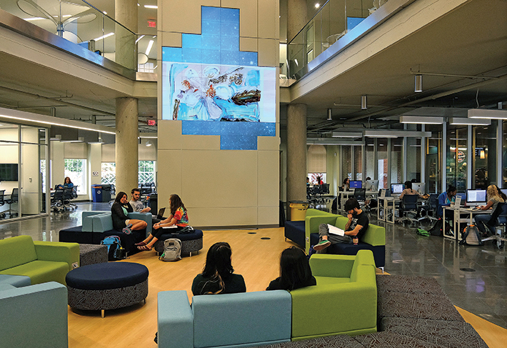 The Information and Technology Convergence Center's media wall serves as a gallery for students' digital work. Photos by Norm Shafer