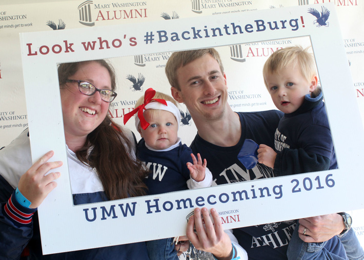 Chrissy Boyer DeMarr '12 and Matthew DeMarr '10 had fun at homecoming with children Mary Anna and Thomas.