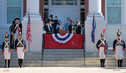 Costumed interpreters gather on the steps of UMW's Monroe Hall to commemorate the inauguration of fifth U.S. President James Monroe, held March 4, 1817. (Photo by Norm Shafer)