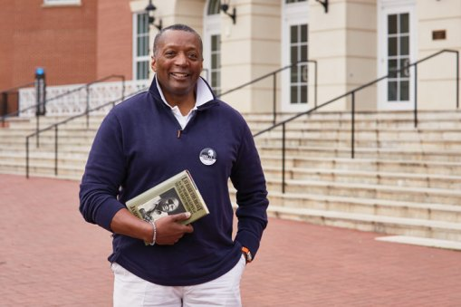 Cedric Rucker '81, associate vice president and dean of student life,said Farmer's influence at UMW continues to shape the curriculum.Here Rucker holds Farmer's autobiography, Lay Bare the Heart. (Adam Ewing)