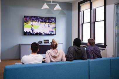 Students watch basketball in one of Willard's spacious new lounge areas before the pandemic forced the university to send students home. (Adam Ewing)
