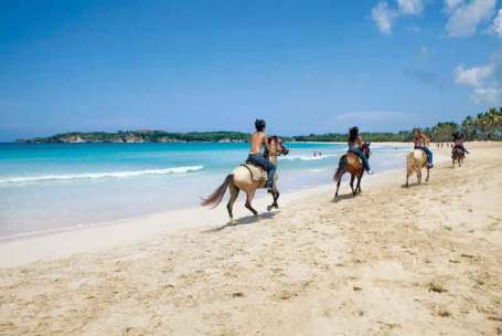 Horseback+riding+at+the+beach-1152622262-O