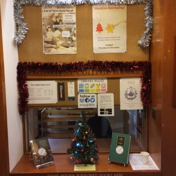 Library entrance with Christmas Tree and new library posters