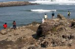 Villagers fishing in Karangbolong beach, Kebumen Regency. Image taken on August 7, 2011.