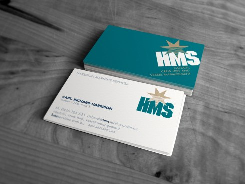 """Stacked Harrison Maritime Services """"HMS"""" business cards showing both sides of the card."""