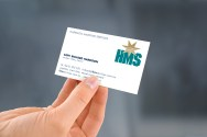 """Hand-held Harrison Maritime Services """"HMS"""" business card."""