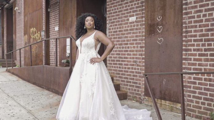 Model in New York wears a romantic A-line wedding dress called Leticia Lynette by Maggie Sottero