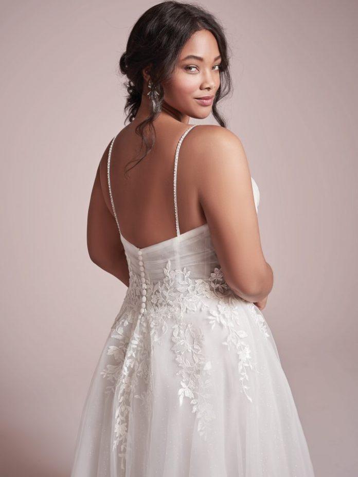 Plus size model wears a light A-line wedding dress called Mila by Rebecca Ingram