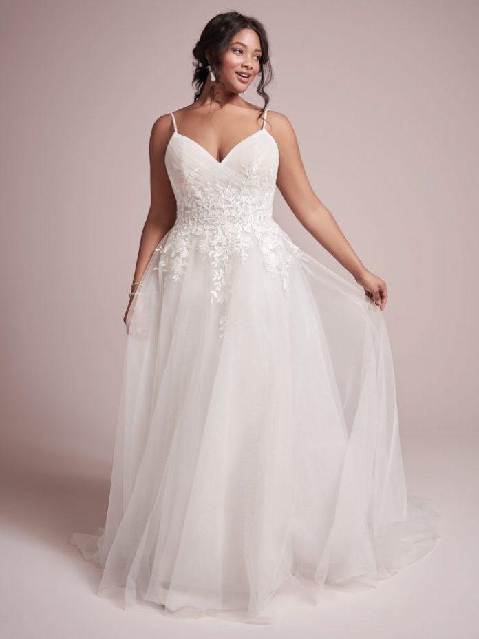 Curvy model wears plus size princess wedding dress named Mila by Rebecca Ingram