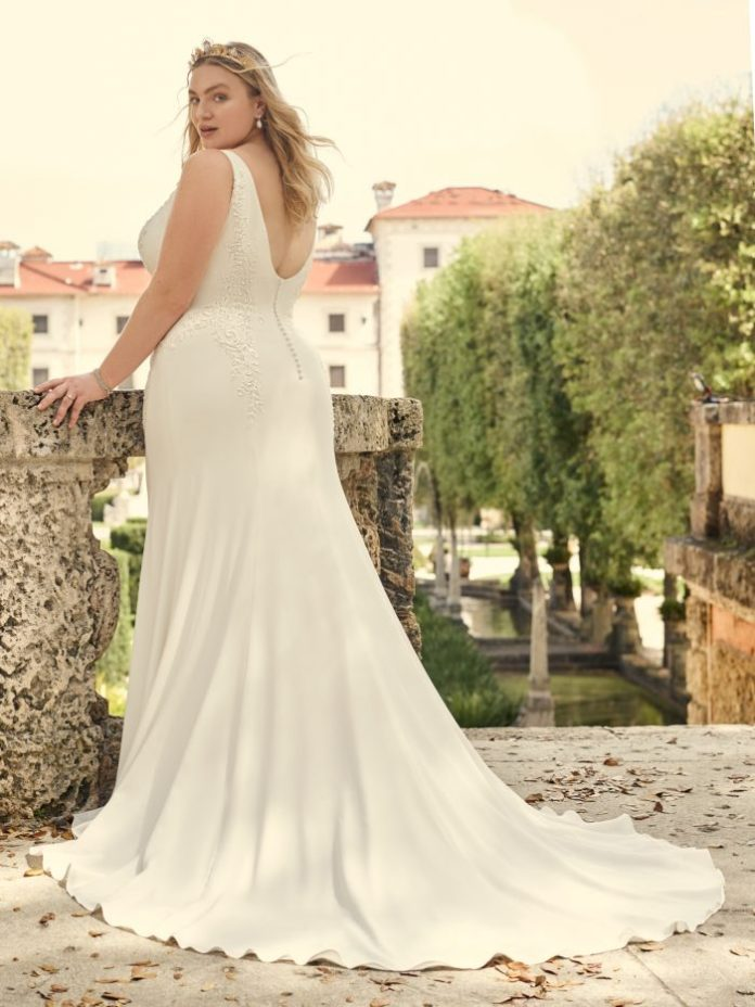 Bride with Crepe Case Plus size wedding dress named Adrianna by Maggie Sottero