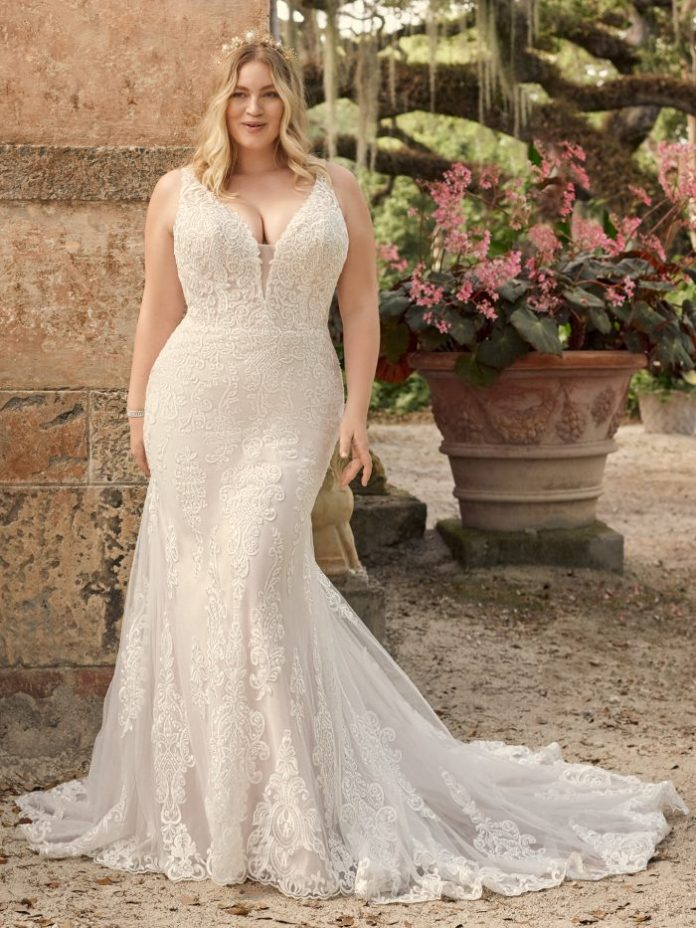 Bride wears plus size vintage lace wedding dress named January by Maggie Sottero
