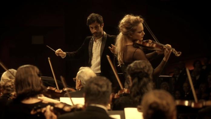 Rodrigo conducts the orchestra and Anna-Maria