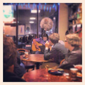 Performing a school project at a coffee house in Boone.