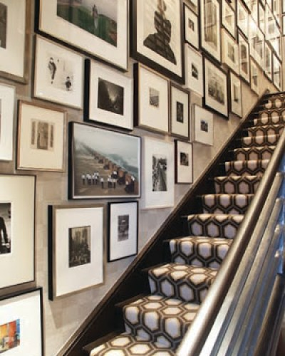 Floor to ceiling gallery wall by designer, Eric Cohler