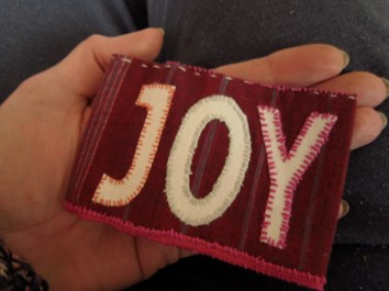 maroon/purple oyster card wallet with hand embroidered white font_