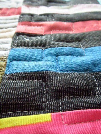 charcoal grey, shocking pink,petrol blue striped quilted cloth for wearable art handbags.