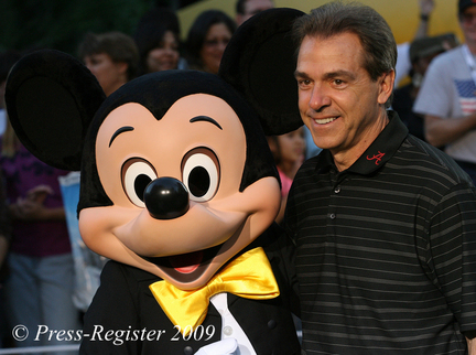 Alabama head coach Nick Saban poses for pictures with Mickey Mouse - Photo by Bill Starling
