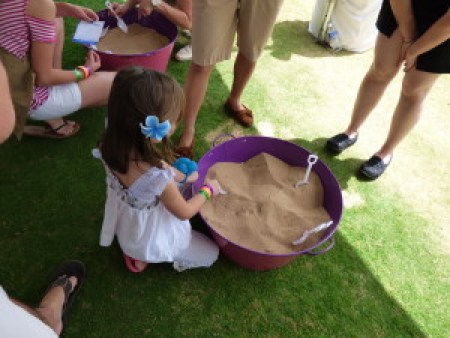 Digging in the sand with a shovel, not hands, to be safe
