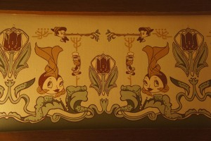Detail of wallpaper border featuring Pinocchio, Jiminy Cricket and Cleo