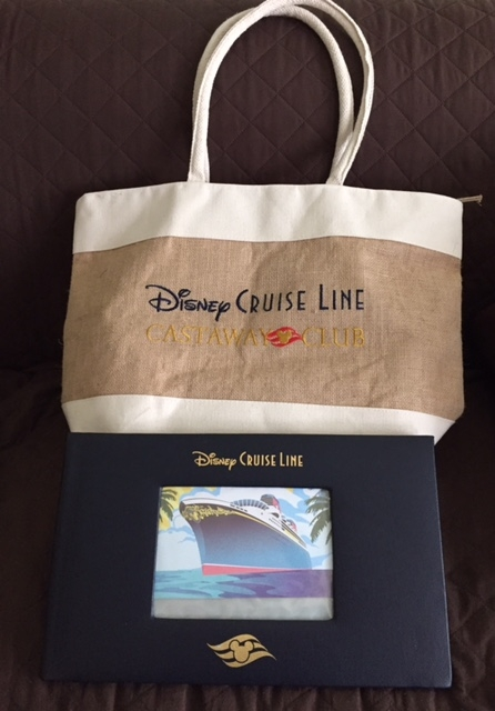 Gold level Castaway Club onboard gift (tote bag and photo album) - Photo by Mary Spina