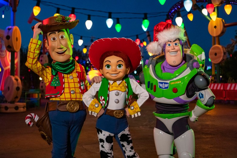 Photo of Woody, Jessie, and Buzz in Toy Story Land for the Holidays
