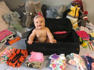 Packing baby airline flight airplane airport travel vacation road trip suitcase carry on checked bag what to pack