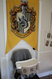 magical mama blog harry potter first birthday party cake smash high chair hufflepuff flag