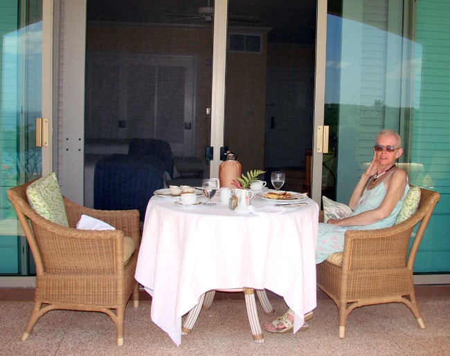 Cathy having breakfast on patio at the Four Season's Resort Lanai. Photo by M. Maxine George