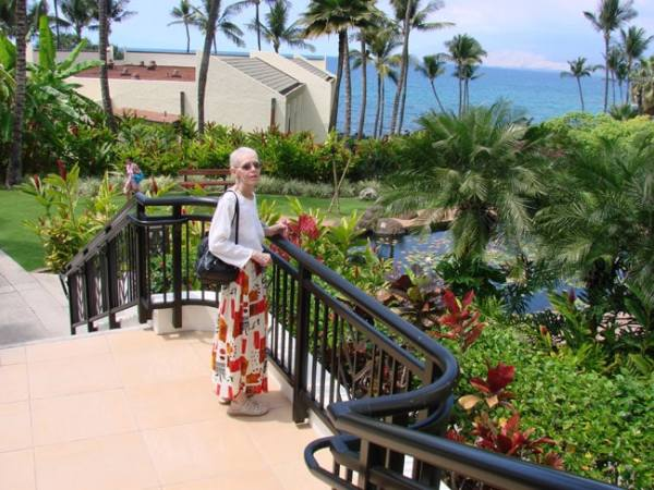 Cathy McDonald on steps at Wailea Beach Resort, Maui. Photo by M. Maxine George