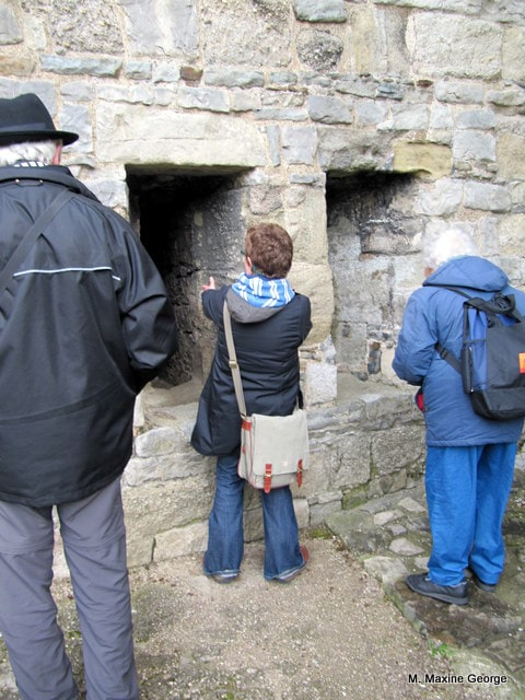 Donna Goodman, our guide explains how the soldiers used the double arrow loops at Caernarfon Castle.
