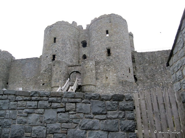 Outside entrance to the Twin-towered Gatehouse at Harlech Castle, once accessed via a drawbridge, now a wooden staircase is sufficient