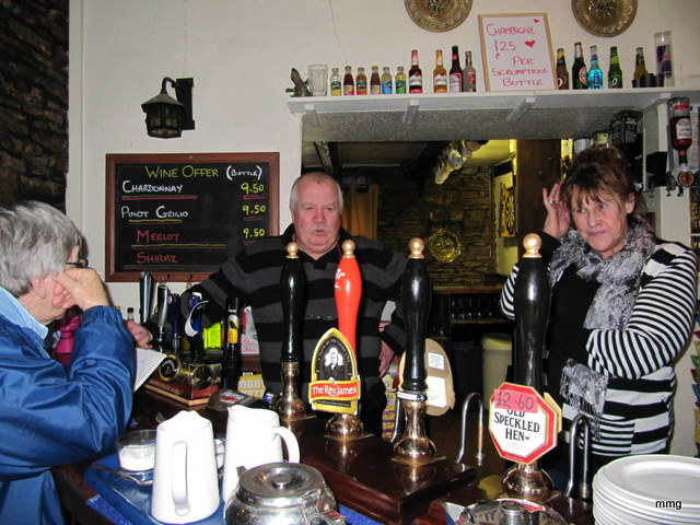 Innkeepers, Geoff and Sandra Fiddler behind bar at Skirrid Mountain Inn. Photo by M. Maxine George