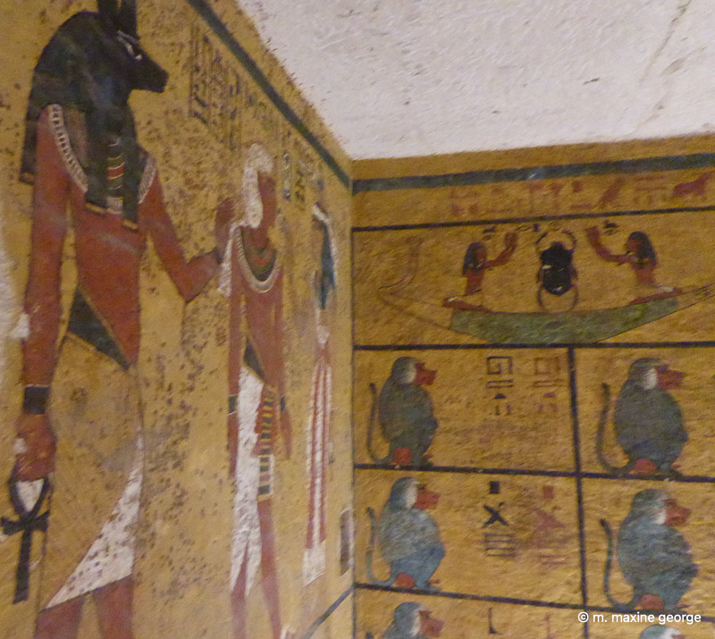 Aye, as the Jackal god who performed the mummification ceremony. Note the scarab or beetle above the monkeys.