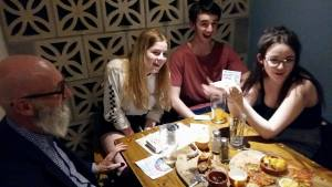 Teenagers enjoying table magic