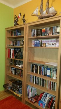 The corner bookcase got all the movies and games - both PC and board ones :D