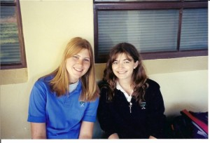 This is a photo of my friend, Jen (L), and me (R) during our senior year of high school. Don't let the uniform or the smiles fool you, we had a knife fight over physics notes immediately after this photo was taken.