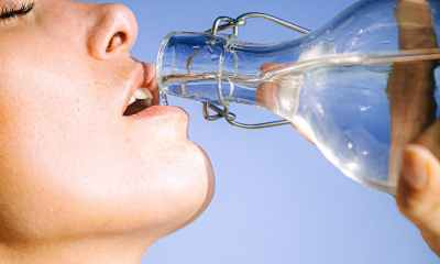 Drinking a glass of water.