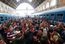 migranţi