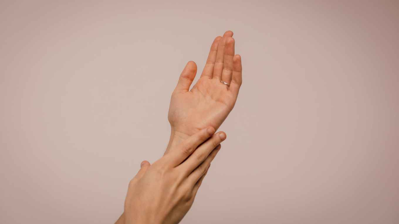 person touching hand