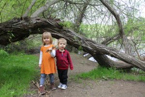 Kid's posing with fallen tree