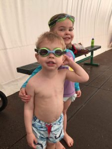 Kids with goggles at swim lessons