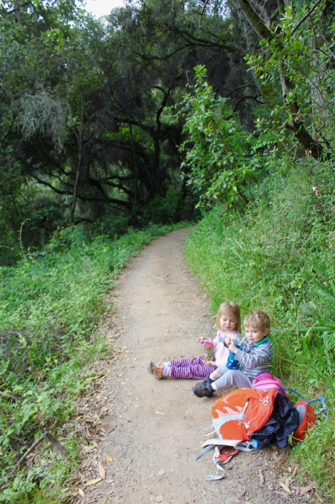 Kids resting on the trail