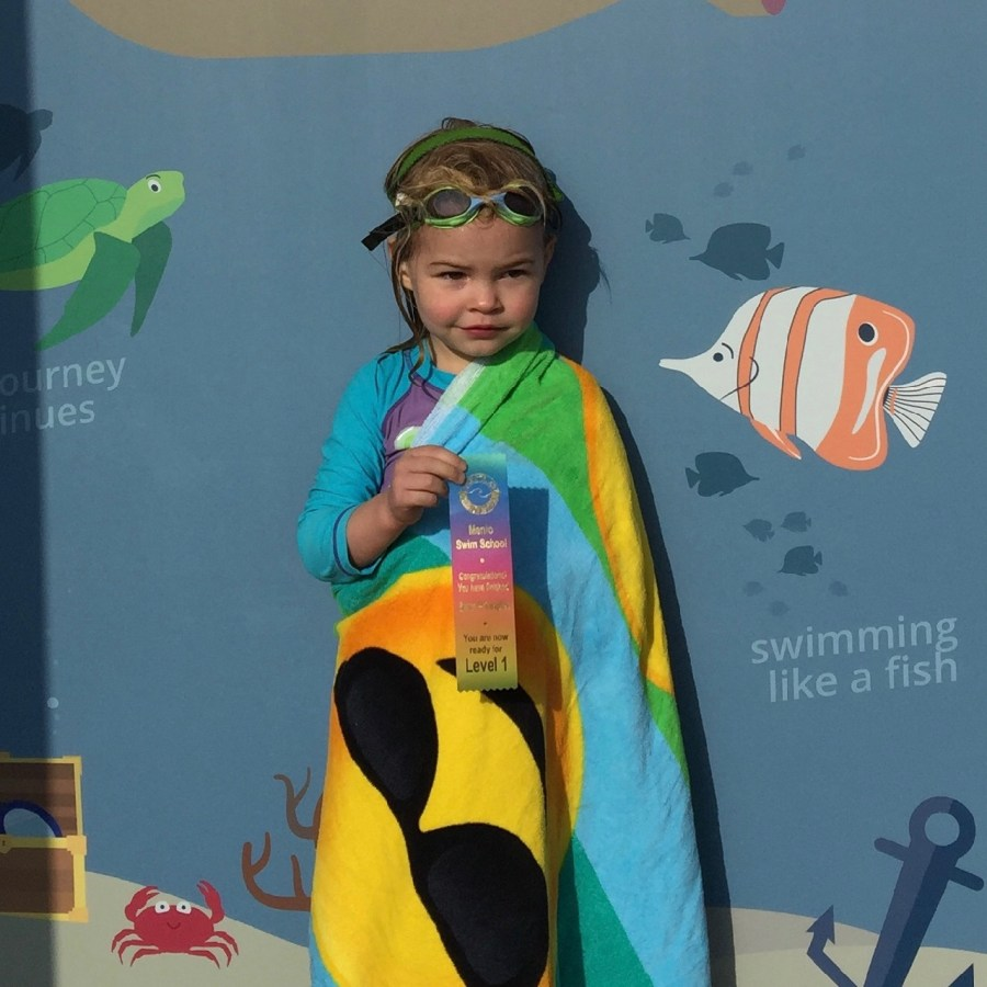 HJ receiving her swim lesson ribbon