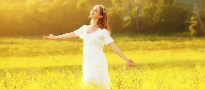 girl in sunny meadow
