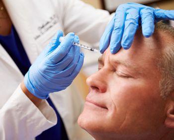 man getting forehead botox treatment