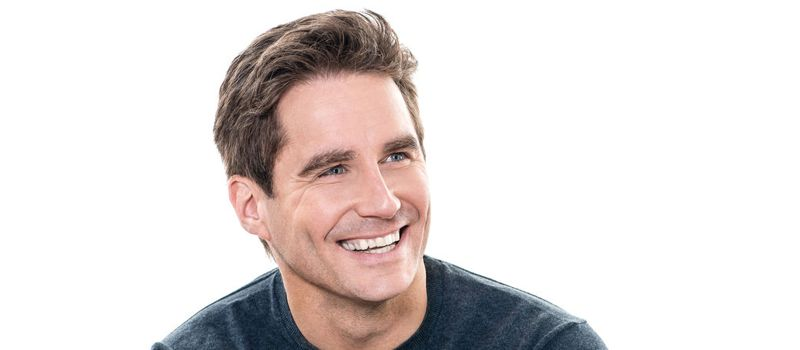 one  man mature handsome man toothy smile portrait studio white background